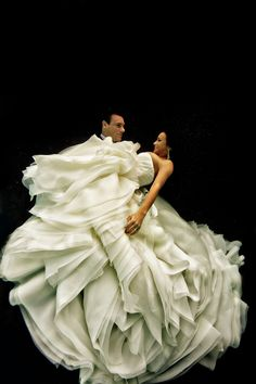 Stunning underwater photographs of brides & grooms