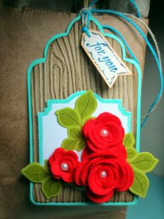 Handmade dimensional rose tag with inked edges created by Cheryl Rowley. Beautiful use of color &woodgrain. #Rose, #RoseTag, #HandmadeRoseTag, #RoseGiftTag, #HandmadeRoseGiftTag, #Tag, #HandmadeTag, #HomemadeTag, #HandcraftedTag, #TagIdea, #Papercraft, #GiftTag, #HandmadeGiftTag, #HomemadeGiftTag, #HandcraftedGiftTag