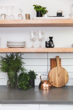 Kitchen Shelf Envy | Henry Design Build Live Concrete countertop with floating wood shelves, white subway tile, dark grout.
