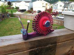 Railroad tie, snail yard art decoration