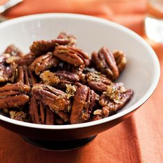 Sweet and Spicy Pecans - a perfect little holiday snack! More easy Thanksgiving Recipes: http://www.bhg.com/thanksgiving/recipes/shortcut-thanksgiving-recipes-from-sara-foster/