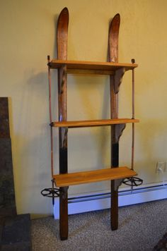 I needed shelves for our cabin, when I remembered we had a pair of antique skis, got creative and came up with this.