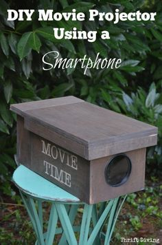 Using just a magnifying glass from The Dollar Tree and some plywood you can make a DIY Movie Projector using just your smartphone. Includes step-by-step instructions and tips for making it work properly! - Thrift Diving Using just a magnify Outdoor Movie Screen, Outdoor Theater, Movie Projector Outdoor, Backyard Movie Screen, Outdoor Cinema, Outdoor Fire, Backyard Movie Nights, Outdoor Movie Nights, Outdoor Movie Party