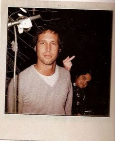 A classic - John Belushi photobombs Chevy Chase back in the day