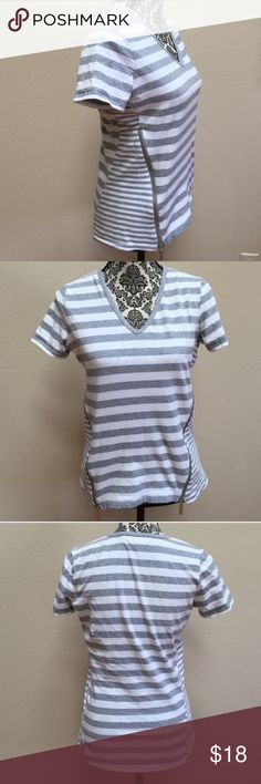 MK striped top This is a gray and white striped, short-sleeve, V-neck top in gently worn condition. Size medium. The top is made from 95% cotton and 5% elastane. Michael Kors Tops
