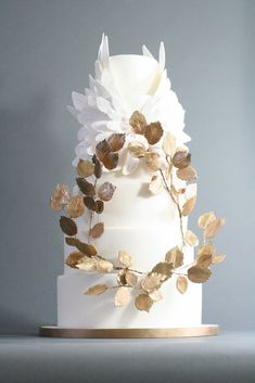 For something spectacular and a little unexpected, we love this cake design that features graceful wings made of sugar soaring above a wreath of sugar leaves that were covered in edible gold leaf.