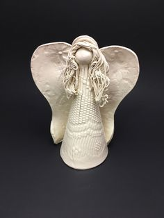 A personal favorite from my Etsy shop https://www.etsy.com/listing/477101194/hand-made-pottery-angel-claire