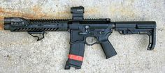 Short Barrel Rifle SBR AR15 with a red Aperture, tactical black, guns, all that is missing is a case of ammo Murica