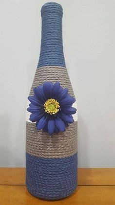 Decorated Wine Bottle blue gray and white striped with Wine Bottle Art, Wine Art, Diy Bottle, Wine Bottle Crafts, Mason Jar Crafts, Wine Bottle Centerpieces, Lighted Wine Bottles, Antique Bottles, Vintage Bottles