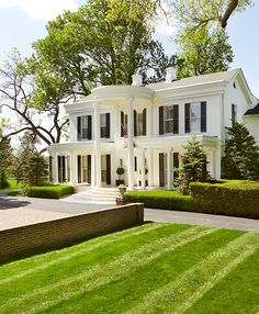Photo Credit: Pieter Estersohn. Maple Hill, C.V. Whitney, Lexington. The stately facade of the Federal-style house is white-painted brick sparked with simple, wood-shuttered windows.