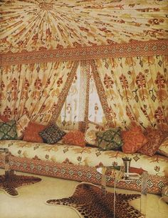 1970: Valentino's Roman penthouse boasts a Turkish tent alcove with motifs the designer selected from a Persian art book, redrawn and printed on linen. Photographed by Horst P. Horst, Vogue, April 1970.