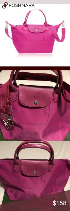 Longchamp Longchamp Color/Material: Nylon And Leather Exterior Design Details: Silver-Tone Hardware Zippered Top. Imported Longchamp Bags Totes