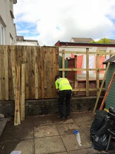 Garden Fence Boards Being Nailed On To The New Frame, A New Garden Fence  Installation