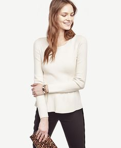 "In refined silk cotton, we've upgraded our ever-popular peplum silhouette with a flattering ribbed hem. Ribbed crew neck. Long sleeves. Ribbed peplum hem. 23"" long."