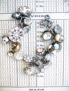 Vintage Rhinestone Button Bracelet Number 29 This bracelet has all vintage rhinestone buttons. There are so many different varieties and sizes, some with lacy bezels, some with clean setting and no prongs, some with gold tone settings, most with silver, all with various signs of age (which we love!...