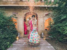 A flower shower as I entered the wedding venue at Mool Sagar. The Mool Sagar is an abandoned building that was said to be the harem of the king centuries ago. We found it to be an overgrown oasis in the middle of the desert. The border on my dress took eight men 75 hours to embroider.