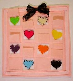 Felt Heart Memory Game. Simple holiday craft idea for Valentine's Day. A great game for the kids to play with and it sharpens memories. #sewing