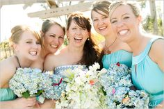 Teal colored bridesmaids with hydrangea bouquets - Photo by Jason