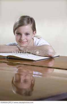 Portrait of teenage girl (13-15) at piano