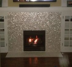Fireplace With Mother Of Pearl Tile And Abalone Shell Tile Also Bookcases With Tv Over Fireplace And Wall Panel Plus Wood Flooring With Fireplace Hearth And Seashell Mosaic Tile Fireplace Surround Mosaic Tile Fireplace, Tile Around Fireplace, Fireplace Tile Surround, Candles In Fireplace, Brick Fireplace Makeover, Shiplap Fireplace, Marble Fireplaces, Fireplace Remodel, Fireplace Surrounds