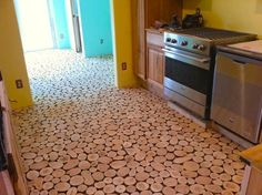 When it was time, they applied a light coat of polyurethane to the surface of the disks. They did this to prevent the grout from adhering to the tops.