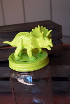 Glue a figurine to a mason jar lid and spray paint it all one color to create a neat storage container... or add a slot to make it a bank. - Mason Jar Projects curated by SavingStar. Save money on your groceries with eCoupons at savingstar.com