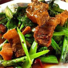 Chinese Broccoli with Crispy Pork Rice Dish :Chinese broccoli stir-fried with crispy pork.