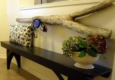 Diy driftwood key holder.  A beautiful solution to your keys can be this driftwood. This is viewed more from the decorative point of view and is really simple to implement. Driftwood is very easy to find , especially if you live near a beach. Along with a couple of hooks this can be a wonderful key holder that also looks really good in your hallway.{found on bringrestoration}.