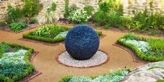 Stone garden sphere made of river-washed black puddle stone or Welsh slate with light permeating the chinks in the stone at night Reflective Sculpture, Water Sculpture, Outdoor Sculpture, Garden Sculptures, Garden Spheres, Garden Stones, Small Backyard Landscaping, Modern Landscaping, Garden Art