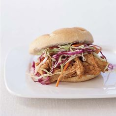 Pulled-Chicken Sandwiches   Classic eastern North Carolina barbecue sauce has a vinegar—not a tomato—base. It's delicious tossed with pulled chicken instead of the usual pork, and served the traditional way: piled onto soft buns and smothered under cold, creamy coleslaw.