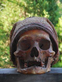 Tribal human skulls......Dayak trophy antique.
