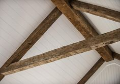 Antique beams combine with a classic beadboard ceiling to create interest and add cottage charm to the gorgeous white great room from HGTV Dream home Rustic Ceiling Beams, Home Living Room, Beadboard Ceiling, Wood Ceilings, Room Pictures, Wooden Ceilings, Rustic Living Room, Great Rooms, Rustic Ceiling