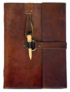 "This simple but elegant handmade leather Book of Shadows contains 120 blank linen parchment pages and a wooden peg to keep it secure. Size: 8"" x 6"" (Due to the handmade nature of this Book of Shadows,"