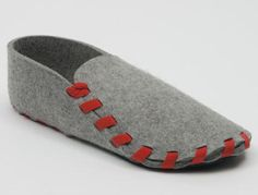 A very neat, flat-pack, laser cut, felt slipper, held together by a shoelace.