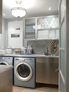 The laundry room attached to that mudroom by Sarah Richardson Design. Cute, however not my dream laundry room. Laundry Room Art, Laundry Room Design, Laundry In Bathroom, Small Laundry, Laundry Area, Basement Laundry, Laundry Storage, Organized Basement, Ikea Laundry