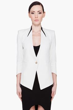 HELMUT LANG Leather Trimmed Era Blazer  Single breasted blazer in ivory tone. V-neck collar with black leather trimmings. Padded shoulders. Single button closure. Vertical darts and faux welt pockets at front. Five button angled cuffs. Slit at back hem. Lined. Tone on tone stitching. 44% cotton, 29% linen, 21% ramie, 6% elastane. Contrast: 100% leather.