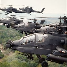 McDonnell Douglas , AH-64A, Apache. Looks like a swarm of locusts. Really big, badass locusts.
