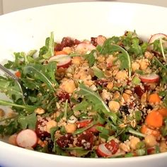 Delicious and substantial  salad using simple, fresh ingredients with whole grains, beans, colorful vegetables, leafy greens, onion or garlic, and nuts.