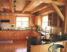 I like the post and beam construction in limited use and in the kitchen. Would have to go with reclaimed lumber and would like it darker.