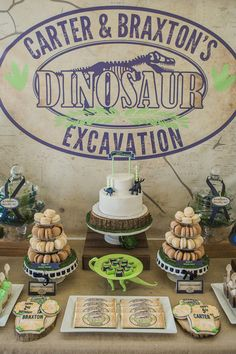 "Crackable dinosaur egg invitations set the tone for this roar-worthy party, and the theme was carried through from the dinosaur terrarium centerpieces to the ""Adopt a Dinosaur"" party favors."