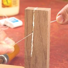 It's easy to coat narrow crevices with glue when you're repairing a cracked board or tenon on a project. Pour glue on a scrap of wood and drag the floss. #WoodworkTechniques