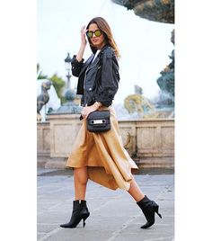 Zina Charkoplia of Fashion Vibe   A ladylike skirt is practically begging for an edgy counterpart like a classic motorcycle jacket.