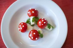 CUTE!!     Tomato Toadstools    cocktail-sized tomatoes (I got mine at Costco. They are bigger than cherry or grape tomatoes.)  white string cheese  herb cream cheese (make your own by adding fresh garlic, chives, salt, pepper, etc. or buy a tub at the store)  Fresh cilantro leaves