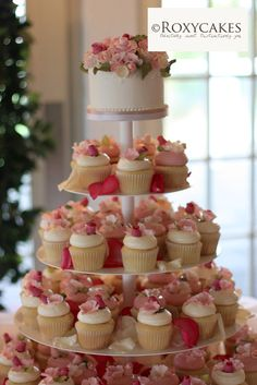 Cupcake tower - i like the idea of rose petals in between.. as 'fillers'