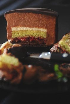 Ambroisie cake with biscuit joconde au chocolat, biscuit aux pistaches, homemade raspberry jam, dark chocolate mousse, pistachio mousse, and...