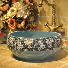 http://www.ebay.com.au/itm/Bathroom-Hand-Painted-Blue-And-White-Porcelain-Galss-Vessel-Sink-Basin-Faucet-/282382664528?