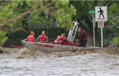 The Calgary Fire Department rescues a family from where they were trapped in their flooded Erlton apartment on Friday morning June 21, 2013. Photograph by: Gavin Young, Calgary Herald