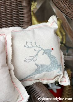 DIY Christmas Drop Cloth Pillows!  Plain drop clothes looks great with red thread and iron on vinyl.