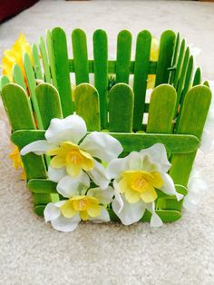 Green Popsicle stick basket with flowers. Can be used for party favors or even hold sweets like cake pops!