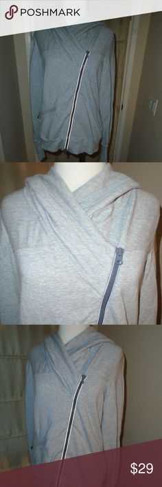 ATHLETA HOODIE GRAY JACKET ~ S ~ POPULAR STYLE ~ Comfortable gray stretch fabric ~ asymmetrical zipper ~ front zip pocket Detailed fabric on the front and hood Good condition Athleta Jackets & Coats